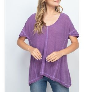Lilac purple inside-out seam curved hem loose top.